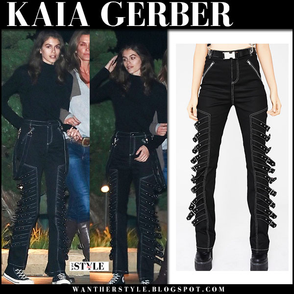 Kaia Gerber in black buckle pants i.am.gia, black top and sneakers converse street fashion march 8