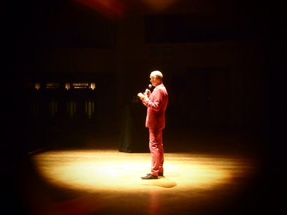 John Waters on stage with his stand-up show This Filthy World