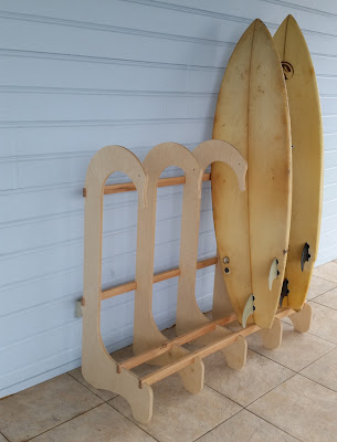 surfboard rack for five boards, with swan's head design