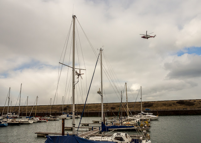 Photo of the helicopter flying over Maryport Marina