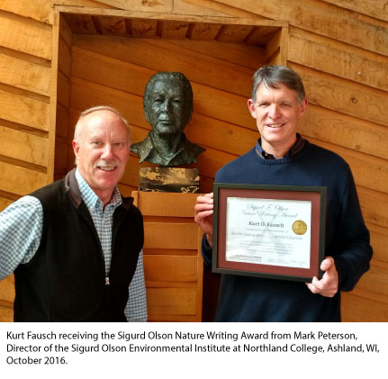 Kurt Fausch receiving the Sigurd Olson Nature Writing Award from Mark Peterson, Director of the Sigurd Olson Environmental Institute at Northland College, Ashland, WI, October 2016