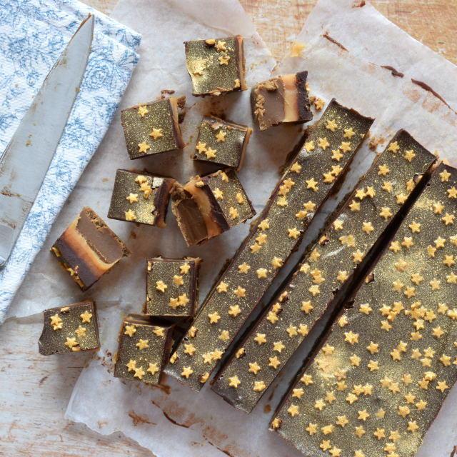 Salted Caramel Millionaire's Fudge finished with edible gold glitter and gold star sprinkles.