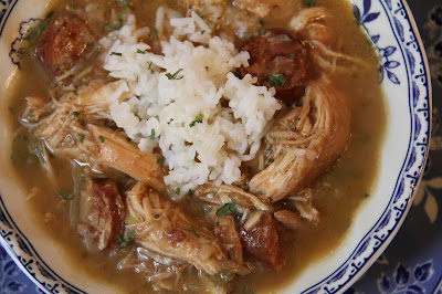 A classic light roux-based gumbo, made with a cut up chicken and andouille sausage, served over hot steamed rice.