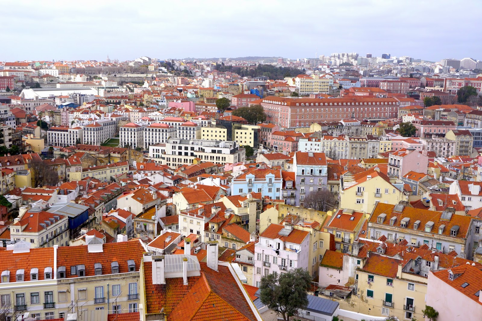 View from Miradouro Da Graca in the morning overlooking the colourful city buildings