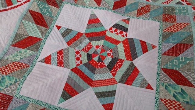 Red and aqua round robin quilt