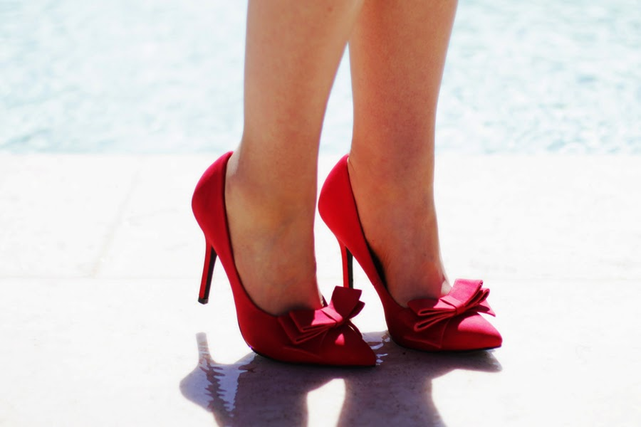 red bow high heel shoes pool