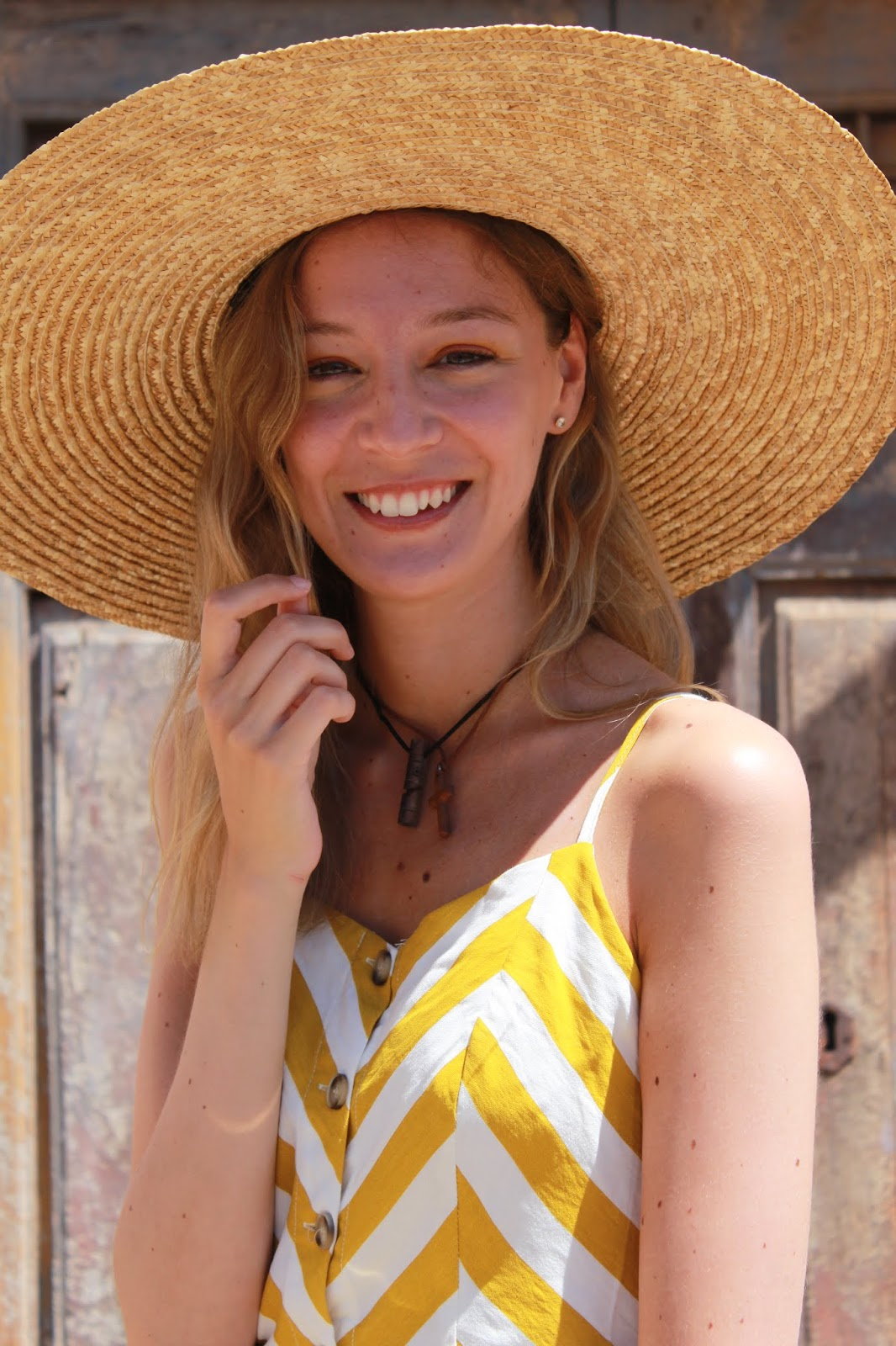 yellow-stripes-midi-dress-straw-hat-straw-bag-leather-espadrilles