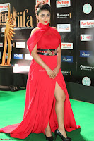 Apoorva in a Stunning Tight Leg Split Sleeveless Red Gown at IIFA Utsavam Awards 46.JPG