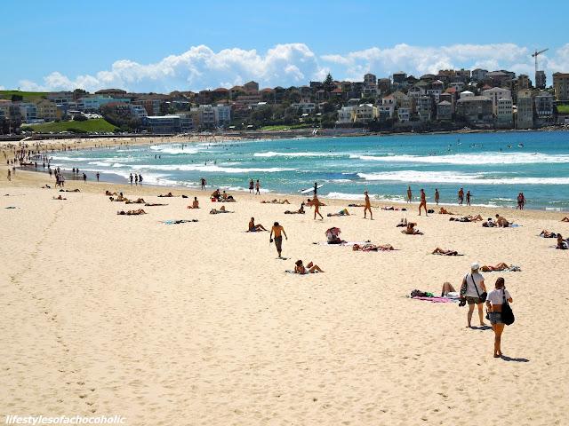people walking on bondi beach in australia