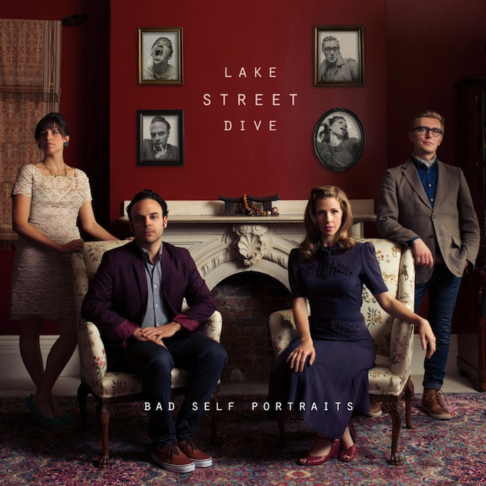 Cover to Lake Street Dive album 'Bad Self-Portraits' — members posing stiffly in a drawing room in front of wall adorned with photos of them making goofy faces