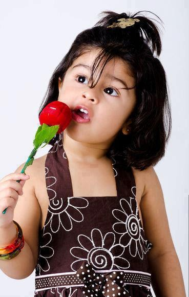 Beautiful Baby Girl With Rose Flower