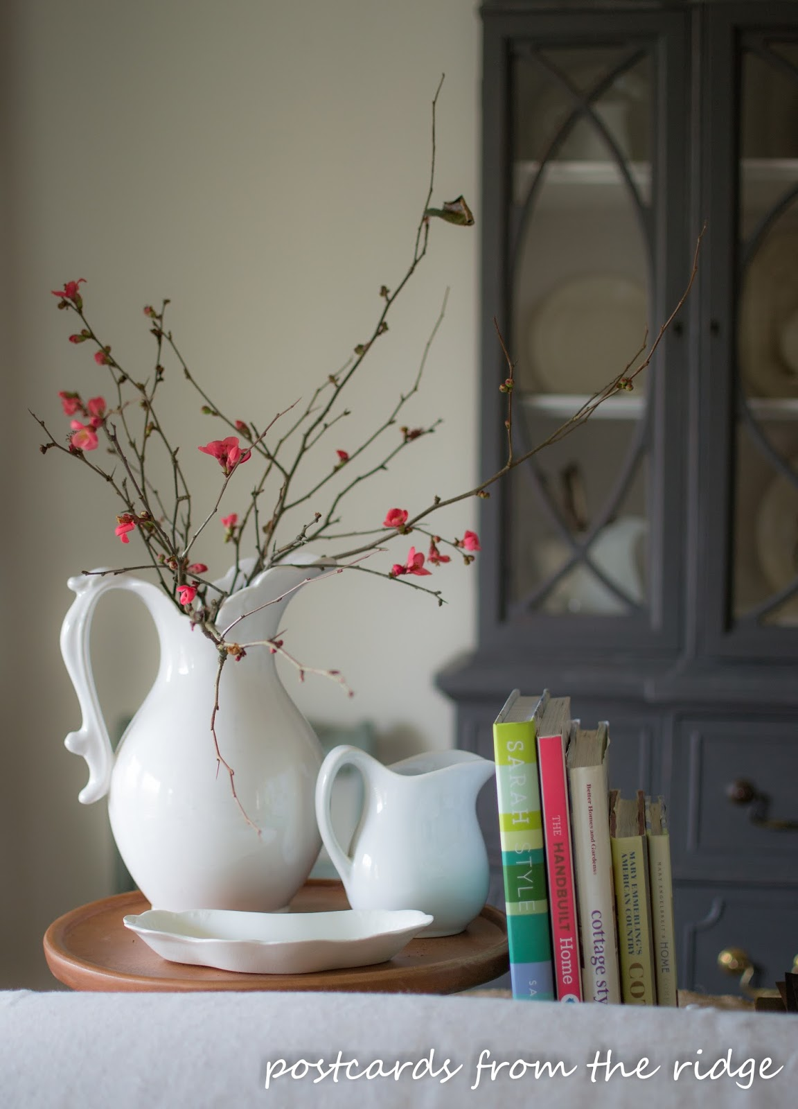 quince branches in an ironstone pitcher