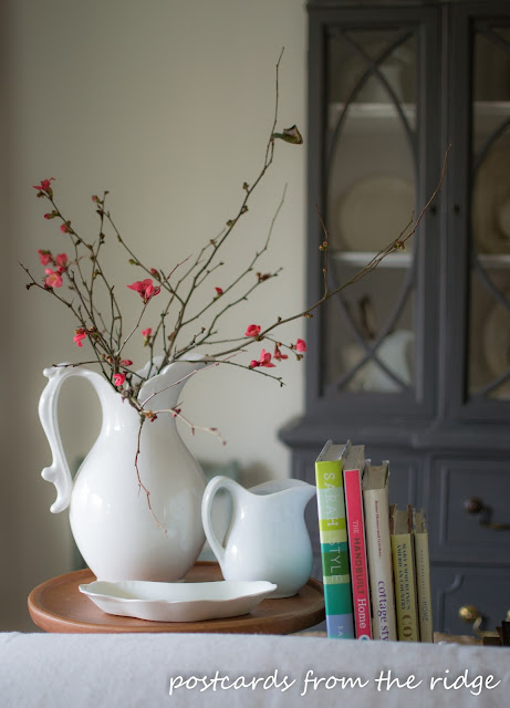 Quince branches in ironstone pitcher. Lots of great decorating ideas on this site. Postcards From the Ridge.