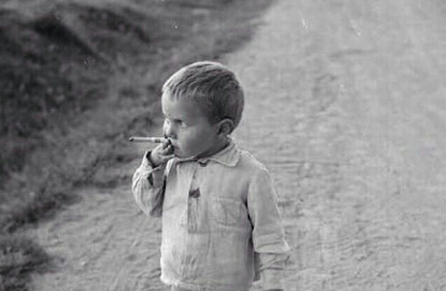 Young boy smoking on Russo-Finnish front, 25 August 1941 worldwartwo.filminspector.com