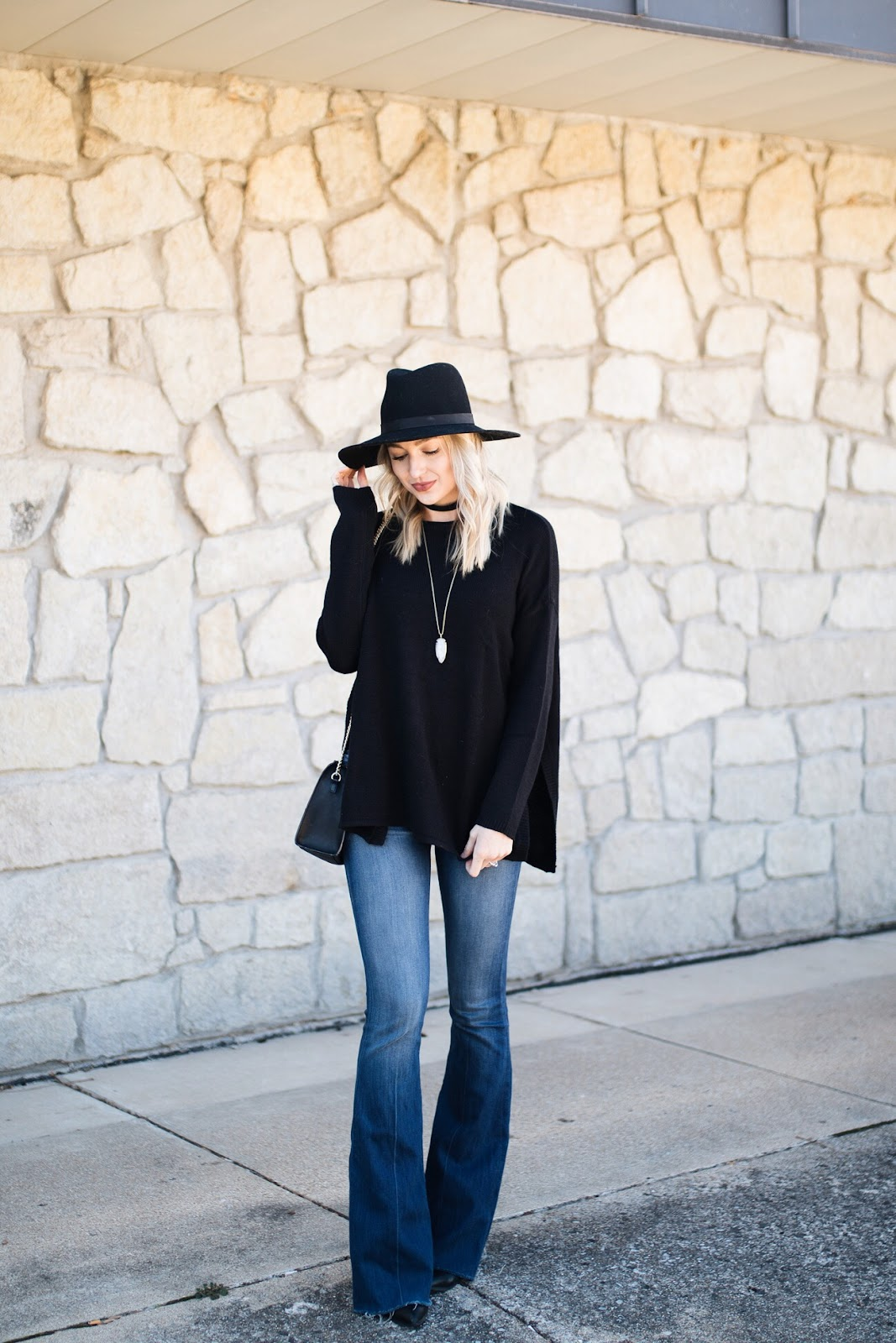 Flare jeans with an oversized sweater