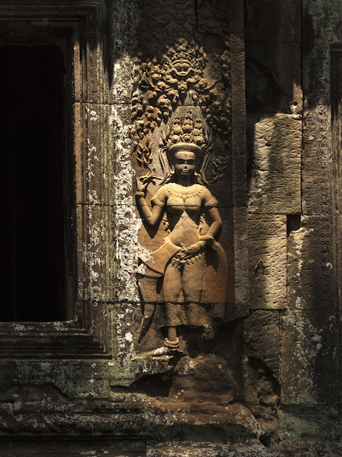 12th century woman carved into the temple wall at Angkor Wat