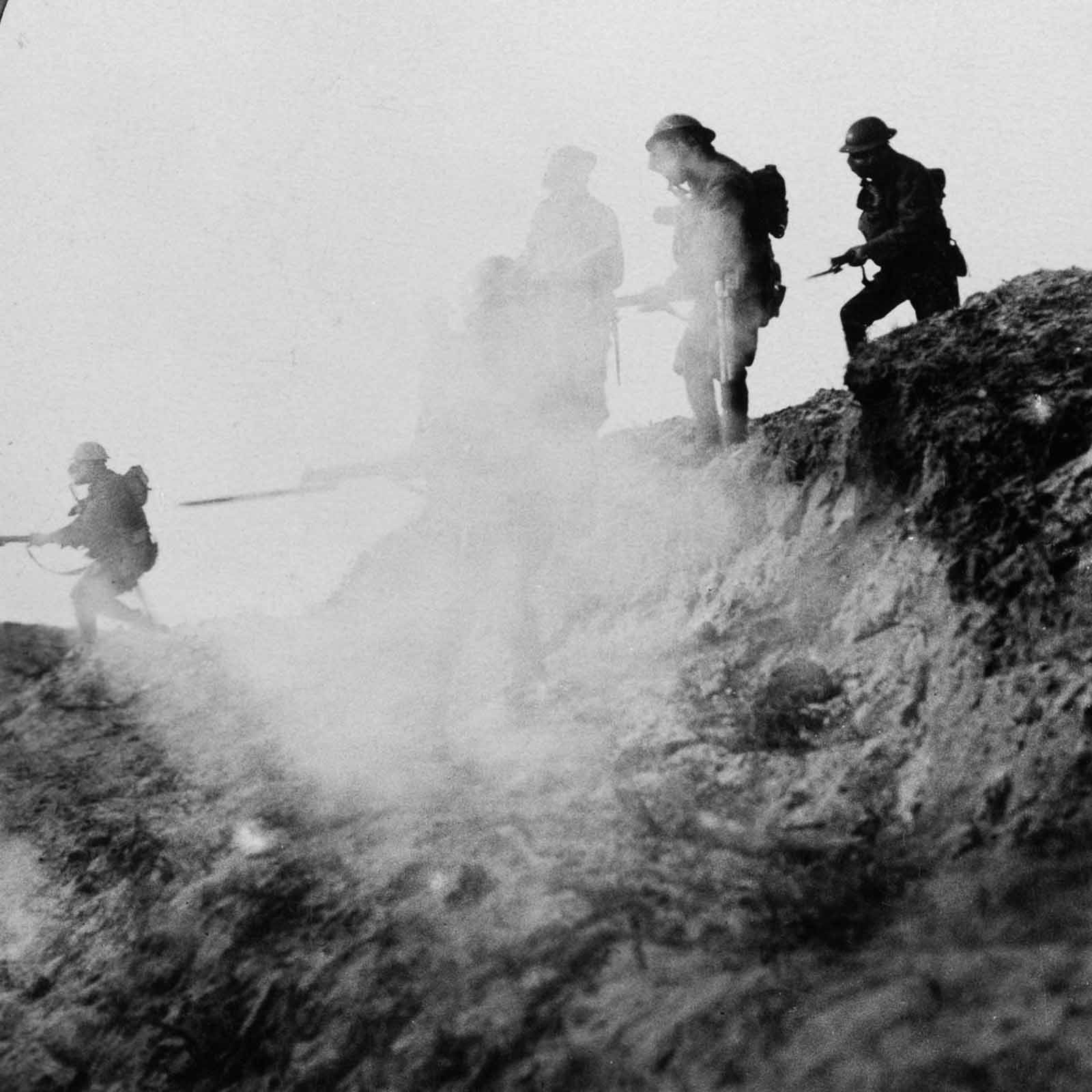 British soldiers advancing under cover of gas and smoke while making a break in the German lines through to Serre and Thiepval. September, 1916.
