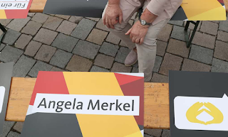 Merkel Has no regrets over refugee policy despite the political cost