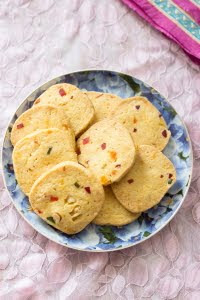 How to make vegetarian eggless Karachi Bakery Fruit Biscuit rose cookies cranberry cookie recipe at One Teaspoon Of Life www.oneteaspoonoflife.com