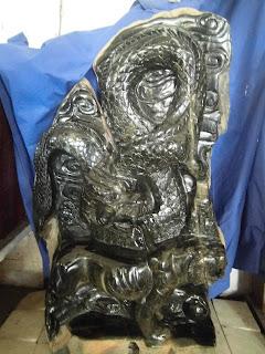 Relief Naga Giok Hitam dan macan
