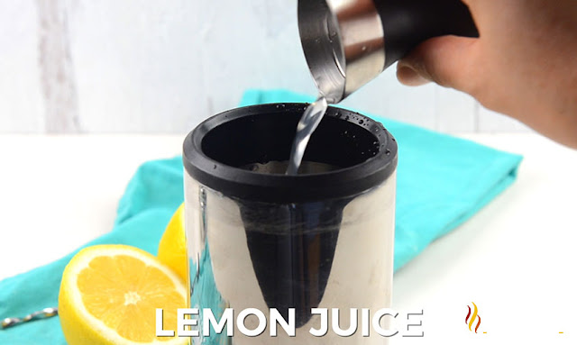 Lemon juice poured into tumbler