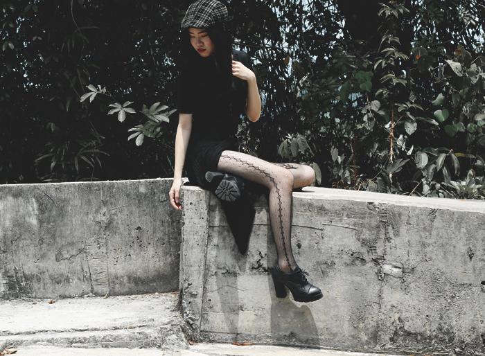 Brunei blogger May Cho in grunge chic fashion, plaid flatcap, all black, fishnet stockings, leather choker