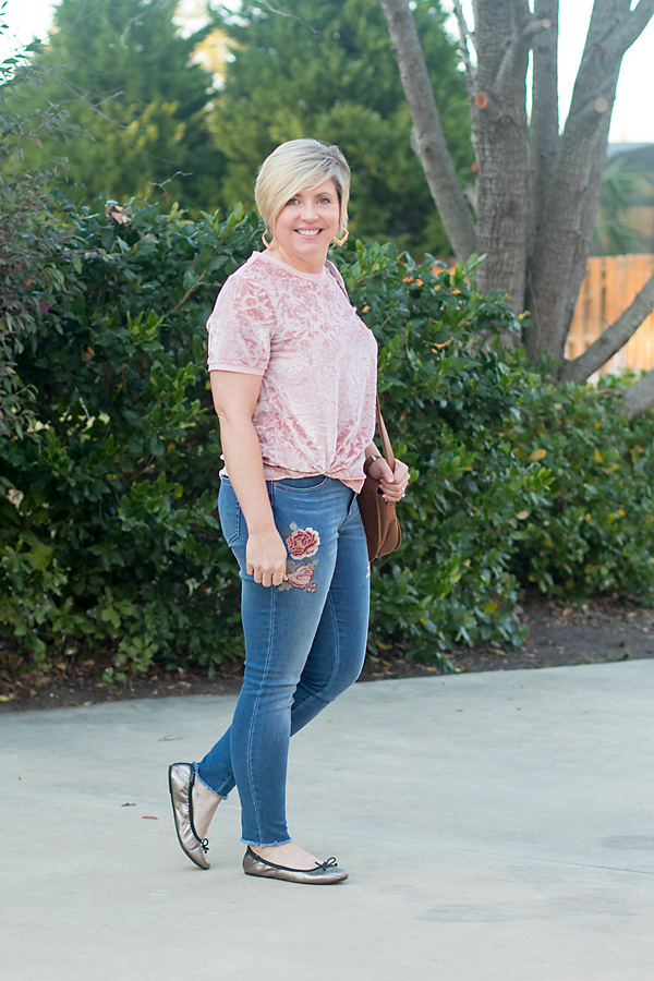 velvet top and embroidered jeans