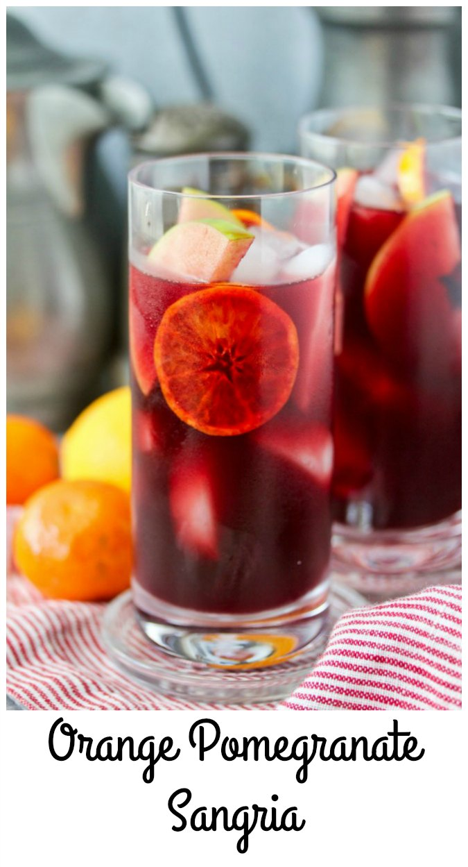 Orange Pomegranate Sangria in highball glasses with apples