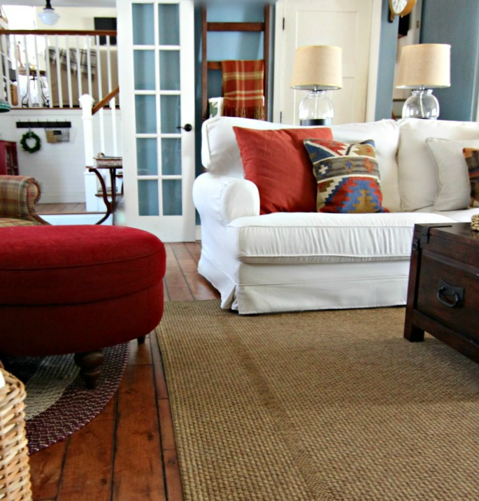 Slipcovered sofa with trunk style coffee table with Pottery Barn kilim throw pillows - www.goldenboysandme.com