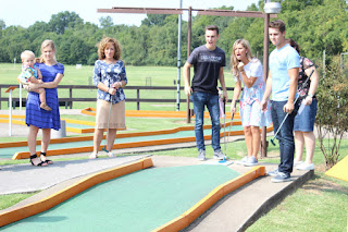 Carlin Bates and Katie Bates go mini golfing with Evan's family