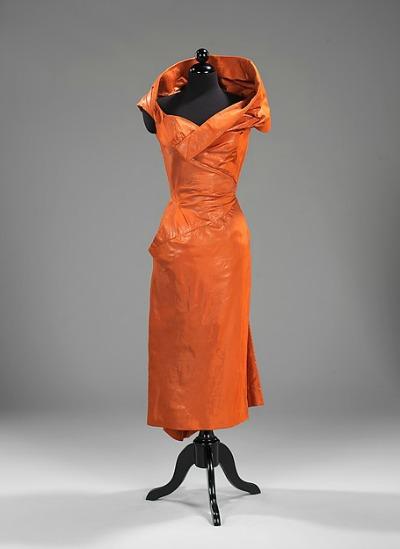 Orange cocktail dress by Charles James displayed on dress form