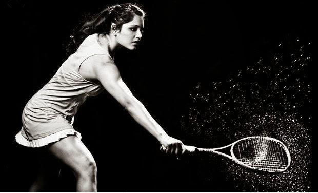 Squash player Dipika Pallikal Playing a shot