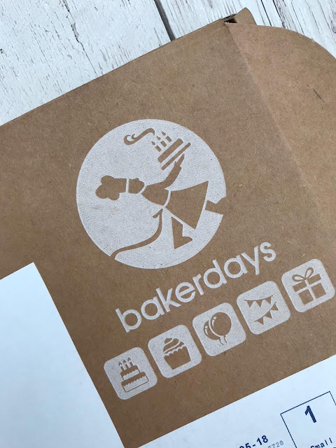 Small letterbox sized box with the name baker days on it