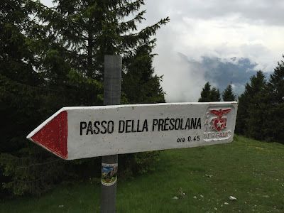 Trail sign pointing to Passo della Presolana