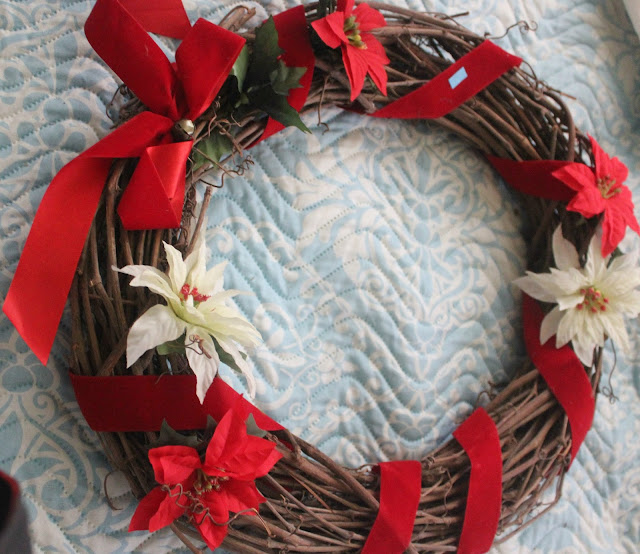 Don't pay attention to how the thrift store wreath looks like. Pay attention to  the main grapevine wreath. thats what you are after. The rest will  go away.