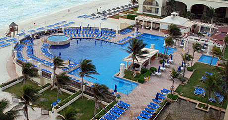 A Cancun Resort Pool: A Complicated Poem