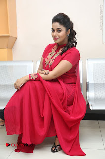 Actress Poorna Latest Stills in Red Dress at Rakshasi First Look Launch  0244.JPG