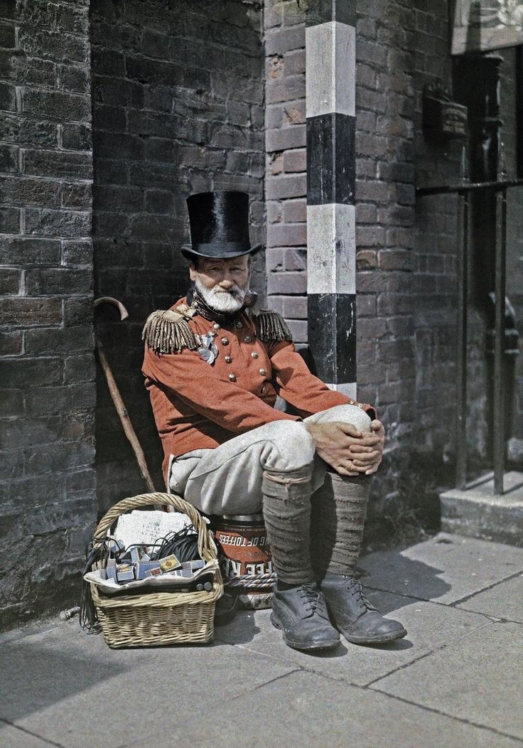 Senior UK war veteran in red uniform jacket  sells matches on the street, in Canterbury, Kent 1928 Speak Your Mind and other stories of Grandmas and reason. marchmatron.com