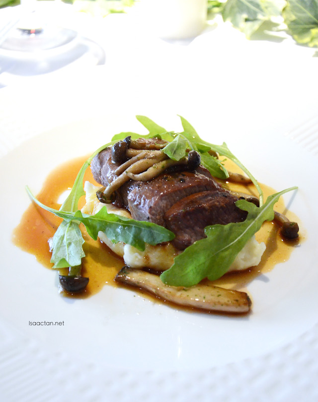 Slow roasted Lamb with sautéed white mushroom, Arugula, Mashed potato with Lamb Jus