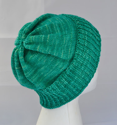 a green slouchy hat for sale at https://www.etsy.com/shop/JeannieGrayKnits