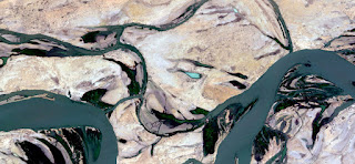 land from the air, stone art, munimara photos, fantasy forms of stone and colors in the desert, aerial, artistic, land, photography, rivers, surreal, waves, yellow gray,
