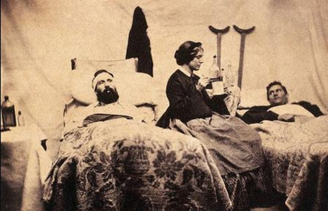 Civil War nurse in a field hospital caring for two wounded soldiers. Angel's Glow. marchmatron.com