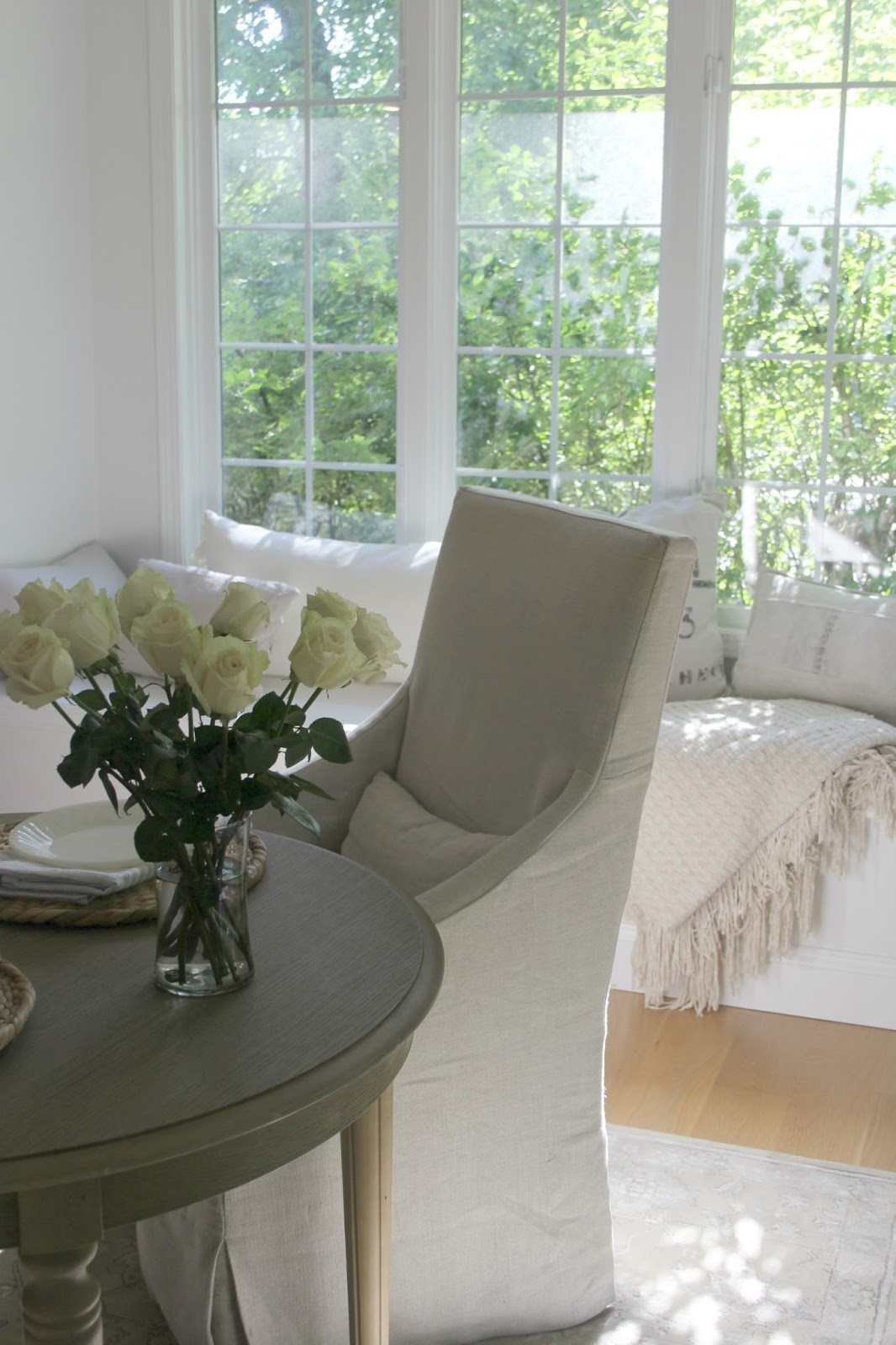 White serene kitchen with window seat - Hello Lovely Studio