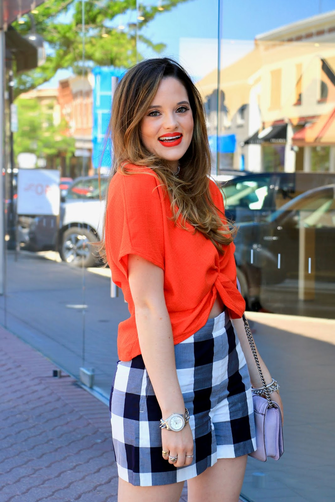 Nyc fashion blogger of Kat's Fashion Fix, Kathleen Harper, wearing plaid shorts in the summer