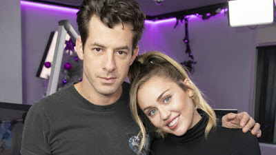 Miley Cyrus & Mark Ronson Take 'Nothing Breaks Like a Heart' and 'Happy Xmas (War Is Over)' to 'SNL'