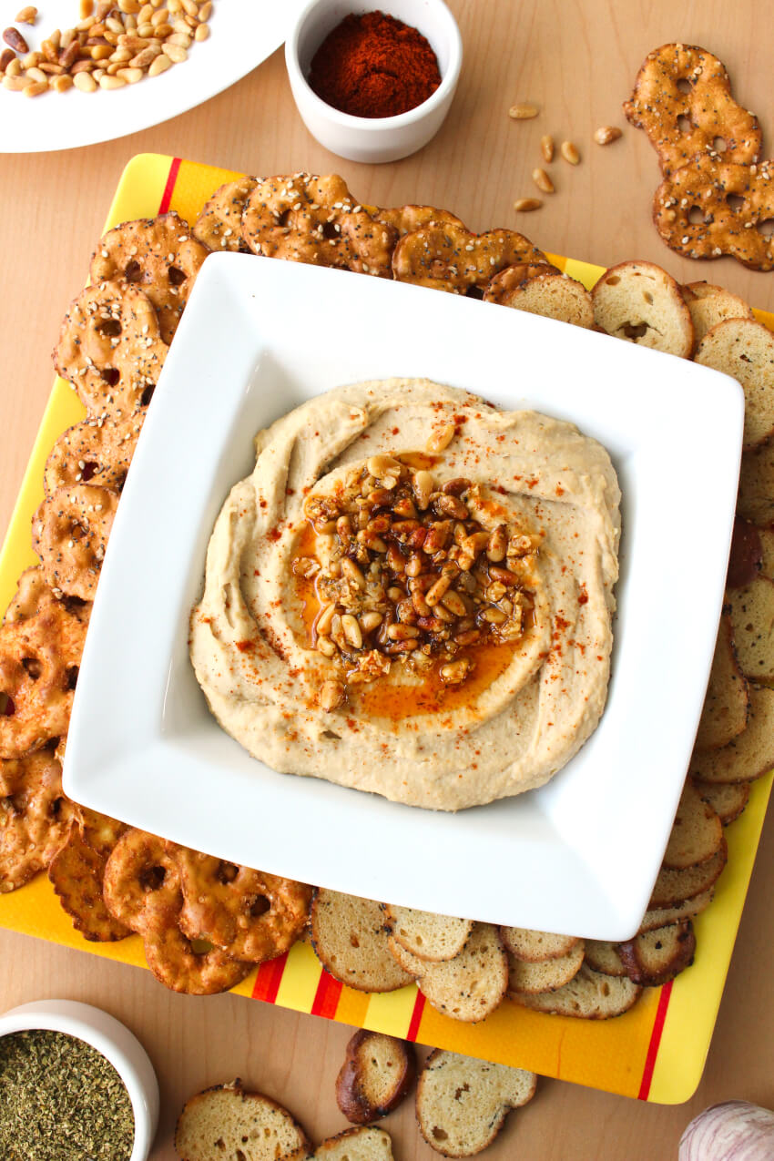 Toasted Pine Nut Hummus is so easy to make at home, you will never want to buy it at the store again. It is perfect to serve as an appetizer, in your lunchbox, or as an after school snack! #hummus #appetizer #diprecipe