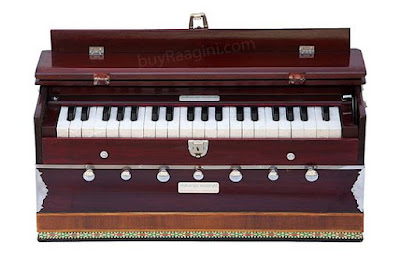 Harmonium  ** Global **  The harmonium is a portable mini pump organ that is very much like a one-handed accordion.