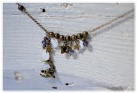 collier asymétrique féerique bronze et indigo