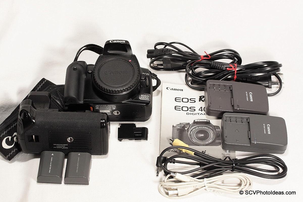 Canon EOS 400D + BG-E3 + accessories + extras