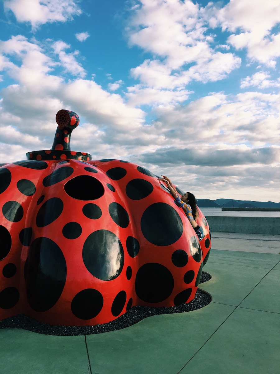 A bright red Yayoi Kusama pumpkin in Miyanoura Port, Naoshima Island Japan